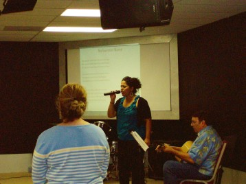 Valerie and Pastor Dick leading worship