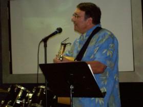 Pastor Dick leading worship in Lubbock, TX