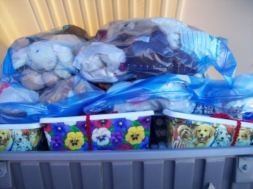 Car carrier full of stuffed animals and Christmas shoeboxes
