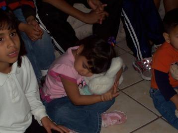 Hugging her new stuffed animal
