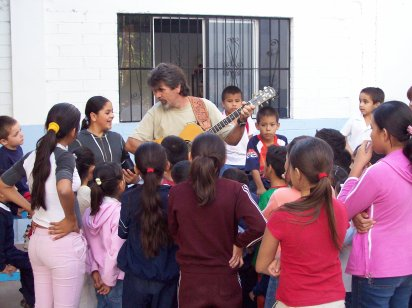 Dave playing his guitar and singing for the kids