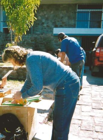 Dee sorting Christmas shoeboxes