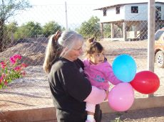 Kathy and a little sweetheart at Mexican orphanage