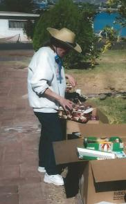 Kathy sorting Christmas shoeboxes