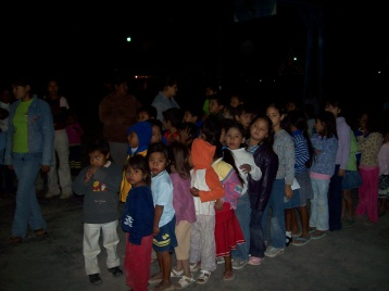 Kids lined up for their gifts