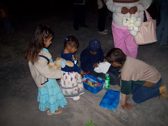 Kids checking out their gifts